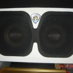 "A pair of 12"" Kicker CVR subs at the back boot"
